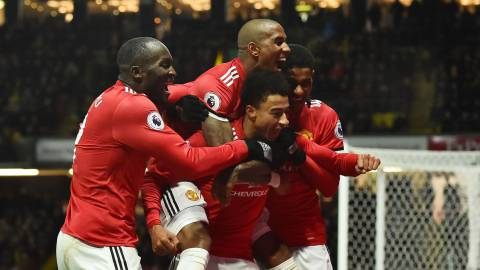 Manchester United's English midfielder Jesse Lingard (C) celebrates with teammates after scoring their fourth goal during the English Premier League football match between Watford and Manchester United at Vicarage Road Stadium in Watford, north of London on November 28, 2017. / AFP PHOTO / Glyn KIRK / RESTRICTED TO EDITORIAL USE. No use with unauthorized audio, video, data, fixture lists, club/league logos or 'live' services. Online in-match use limited to 75 images, no video emulation. No use in betting, games or single club/league/player publications.  /